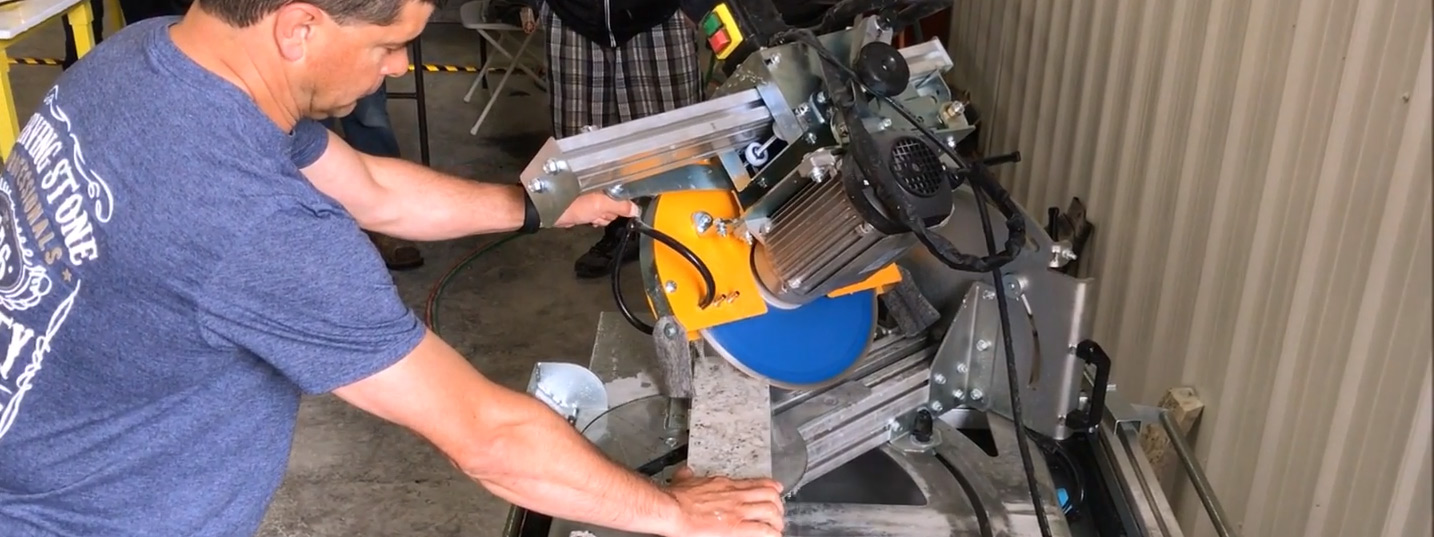 Man Cutting Stone With Miter Saw